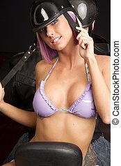 Bikini Biker - Woman on the back of a motorcycle wearing a...