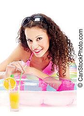bikini girl drinking juice