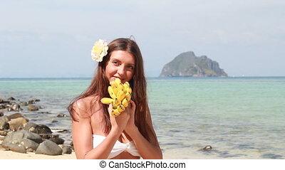 Bikini Girl eats a banana