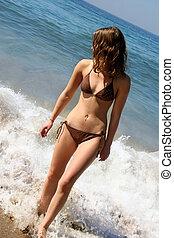 Bikini girl with her belly button pierced