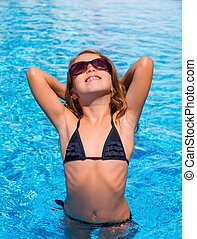 bikini kid girl with fashion sunglasses posing