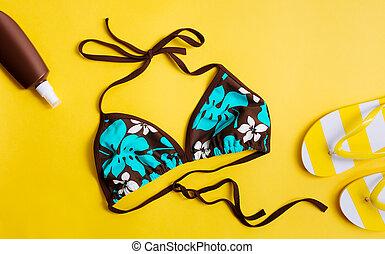Bikini on a yellow background.