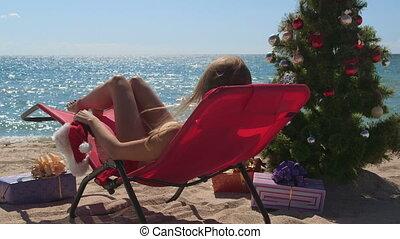 Bikini woman celebrate Christmas on tropical beach