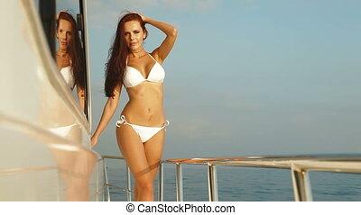 Bikini Woman Enjoying Yacht Vacation, Looking At Camera