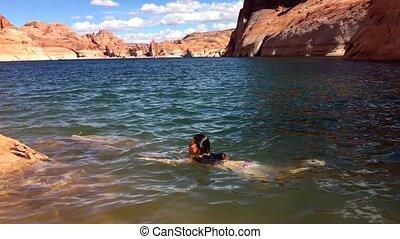 Bikini Woman taking a relaxing bath in the Lake Powell Utah