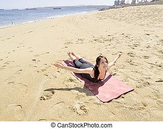 yoga salabhasana pose sporty muscular young yogi man