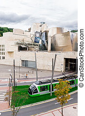 BILBAO, SPAIN - OCTOBER 1: Exterior of The Guggenheim Museum and Tram transport on October 1, 2013 in Bilbao, Spain. The Guggenheim is a museum of modern and contemporary art designed by Canadian-Amer