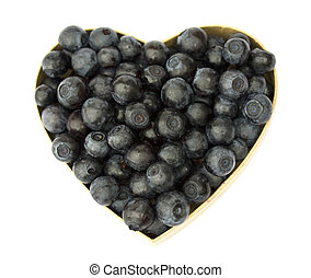 Bilberries (eruopean blueberries) in heart shaped box, isolated on white background