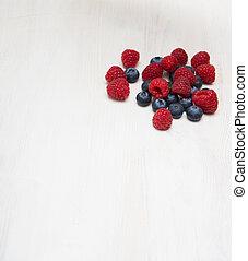 bilberry raspberry on a wooden board
