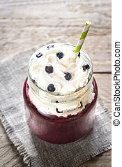 Bilberry smoothie with whipped cream