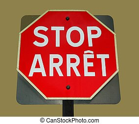 bilingual stop sign - stop sign in french and english