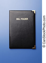bill folder - close of the gratuity on the blue background