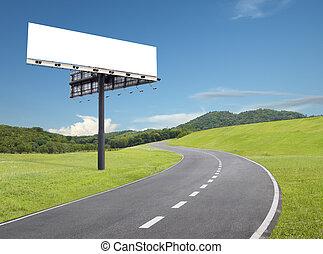 billboard by the road - blank billboard beside an empty ...