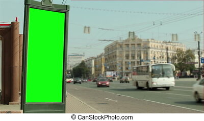 Billboard in the city near road - green screen