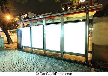 billboard on bus stop at night