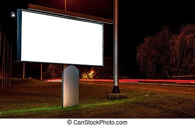 Billboard on highway by night