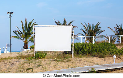 Billboard on the background of palm trees