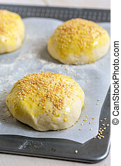 Billets dough for baking buns with sesame seeds.