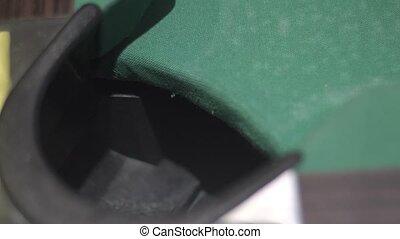 Billiard ball falling into the billiard pocket