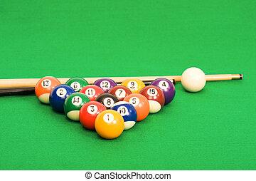 Billiard balls arranged on a green pool table - Billiard...