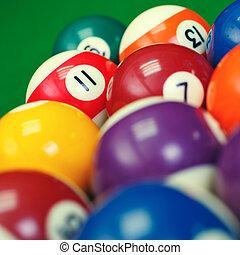 billiard balls on a green pool table, closeup