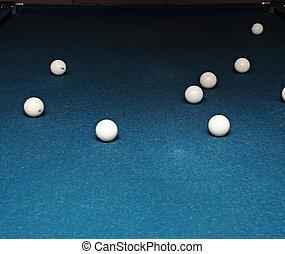 Billiard balls on table on blue table