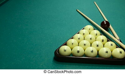 billiard balls on the table with the cue