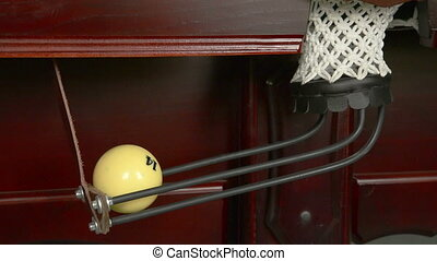 Three billiard ball falls into a pocket. Close-up.