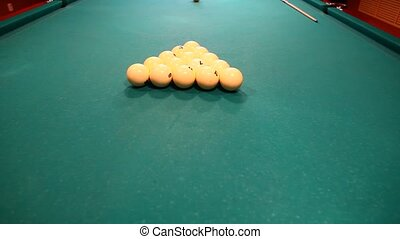 Close-up of billiard balls on a green table