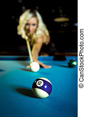 billiard girl - a young  woman playing billiard