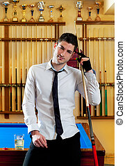 Billiard handsome young man with shirt cue and tie