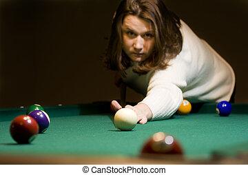 Billiard - Playing pool � a player takes aim