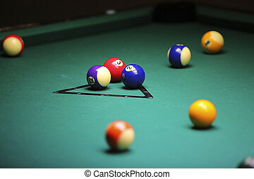 Pool balls on green pool table