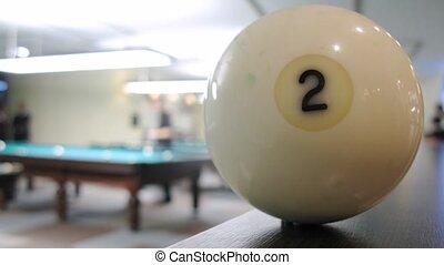Billiard sphere lie on wooden shelf closeup, time lapse