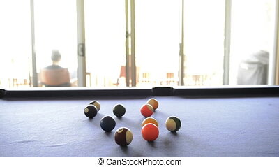 A billiard ball rolls across the table in high definition footage