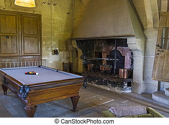 Billiard table in the room of the old castle.