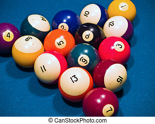 Billiards balls on a green pool table