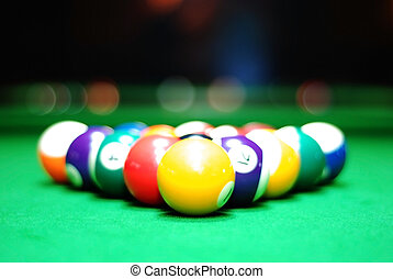 Billiards balls on the green table