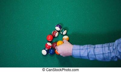 Billiards club. Colored balls. Replacing the balls position....