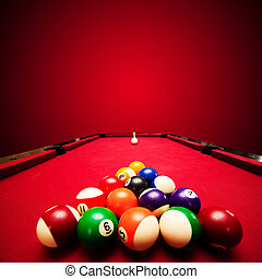 Billiards pool game. Color balls in triangle, aiming at cue ball. Red cloth table