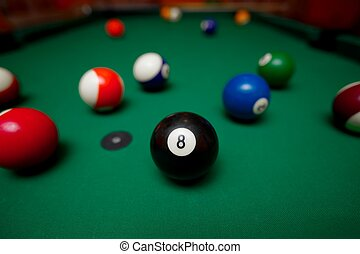Billiards - Pool table with the black ball in the middle