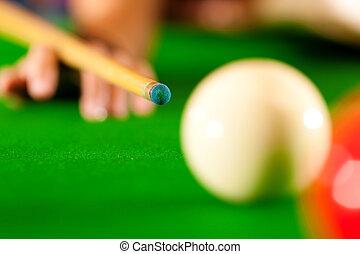 Billiards - Somebody in a billiard hall playing Billiard,...