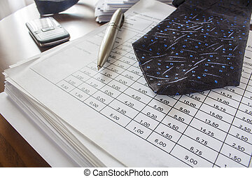 bills ,pen, cell phone and necktie, accounting