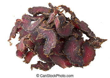 Biltong, a South African cured meat delicacy, on a white background.