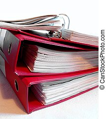 Three old, red binders on white background