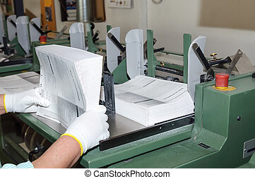 Binding of books in printing house