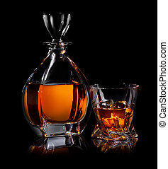 Binge on black - Decanter and glass of whiskaey on black ...