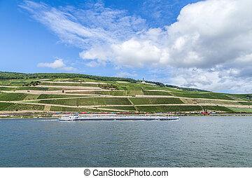 freight ship passes the vineyards at the Niederwald memoria...
