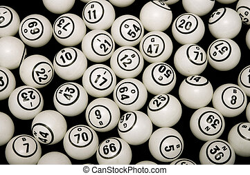Bingo - Black and white bingo balls with numbers on a black...