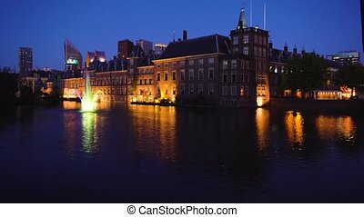 view of Binnenhof - Dutch Parliament at night over Hofvijver pond at night, Hague Holland